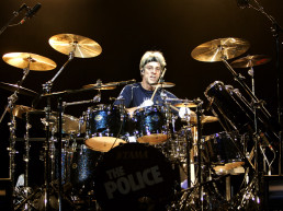Drummer Stewart Copeland of the 80's iconic British pop rock band The Police performs with the band before a sold out TD Banknorth Garden in Boston, Sunday, Nov. 11, 2007. (AP Photo/Robert E. Klein)